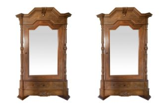 Pair of cabinets with mirror to one door.