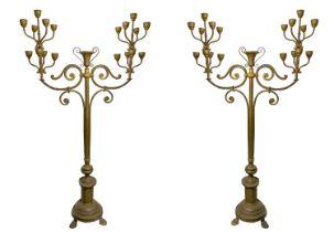 Pair of important golden brass candelabra