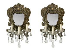 Pair of small mirrors with three lights.