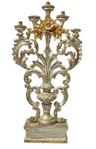 Candlestick in silver and golden wooden five candles, figured in vase with leaves and flowers.