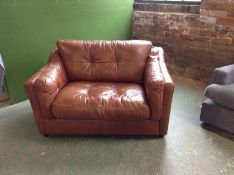 BROWN LEATHER SNUG CHAIR (SCUFFED ON BACK CORNERS