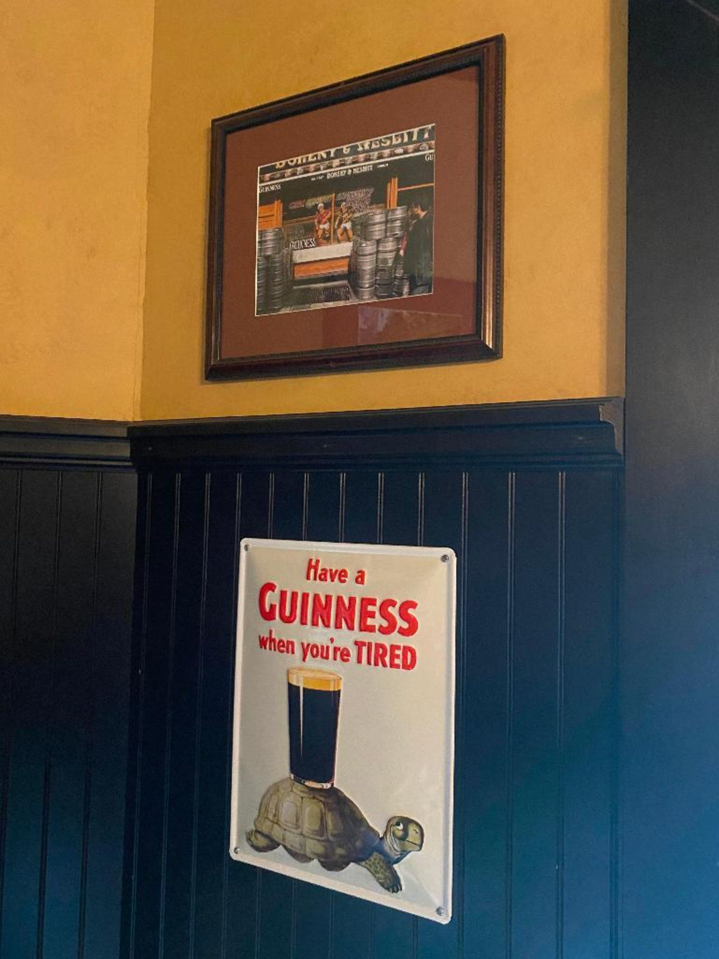 LOT OF (3) FRAMED MEMORABILIA PHOTOS & (1) METAL GUINNESS ADVERTISING SIGN - NOTE: REQUIRES REMOVAL