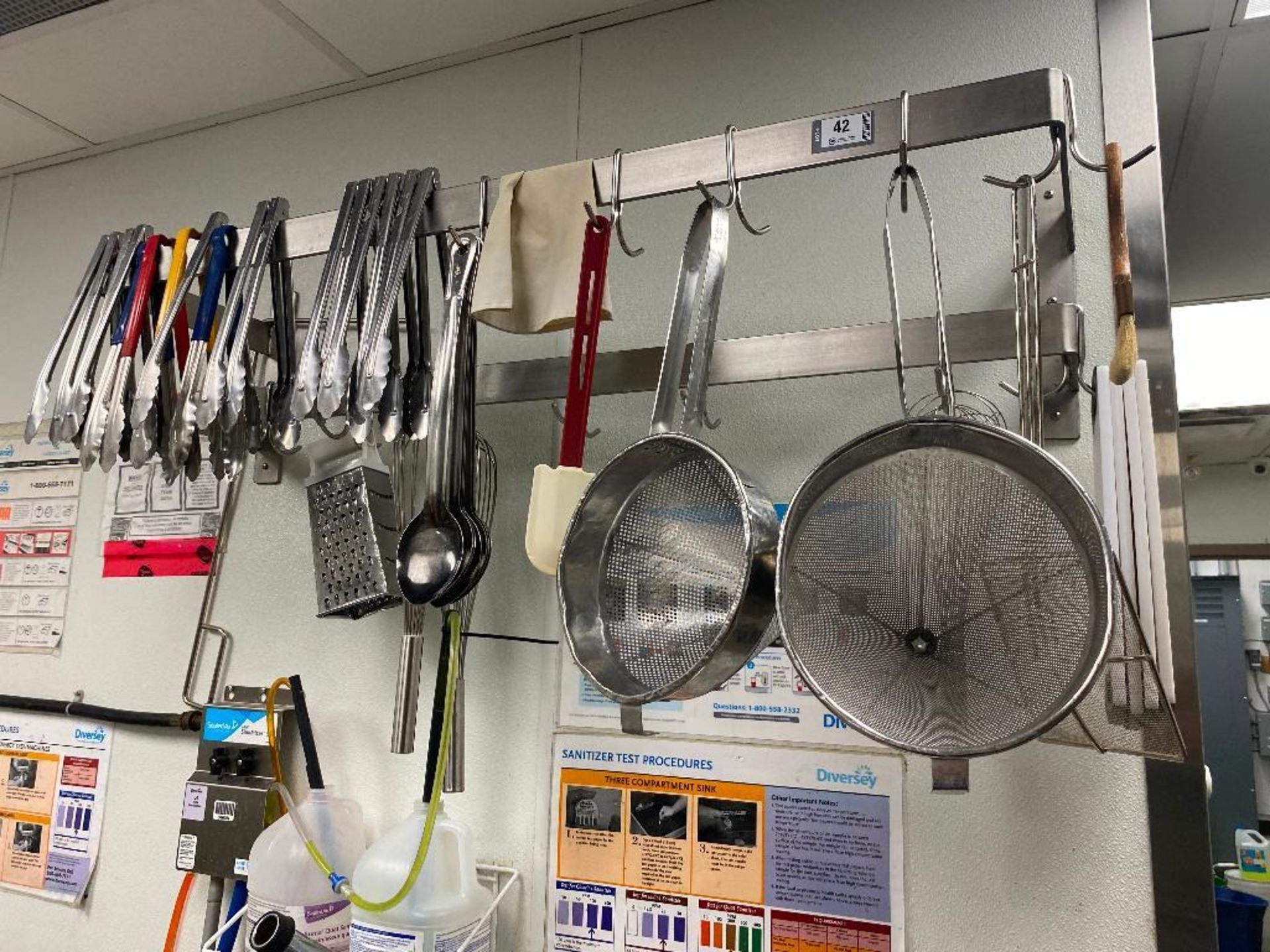 WALL MOUNTED POT SHELF WITH ASSORTED KITCHEN UTENSILS, CUTTING BOARDS & MORE - NOTE: REQUIRES REMOVA