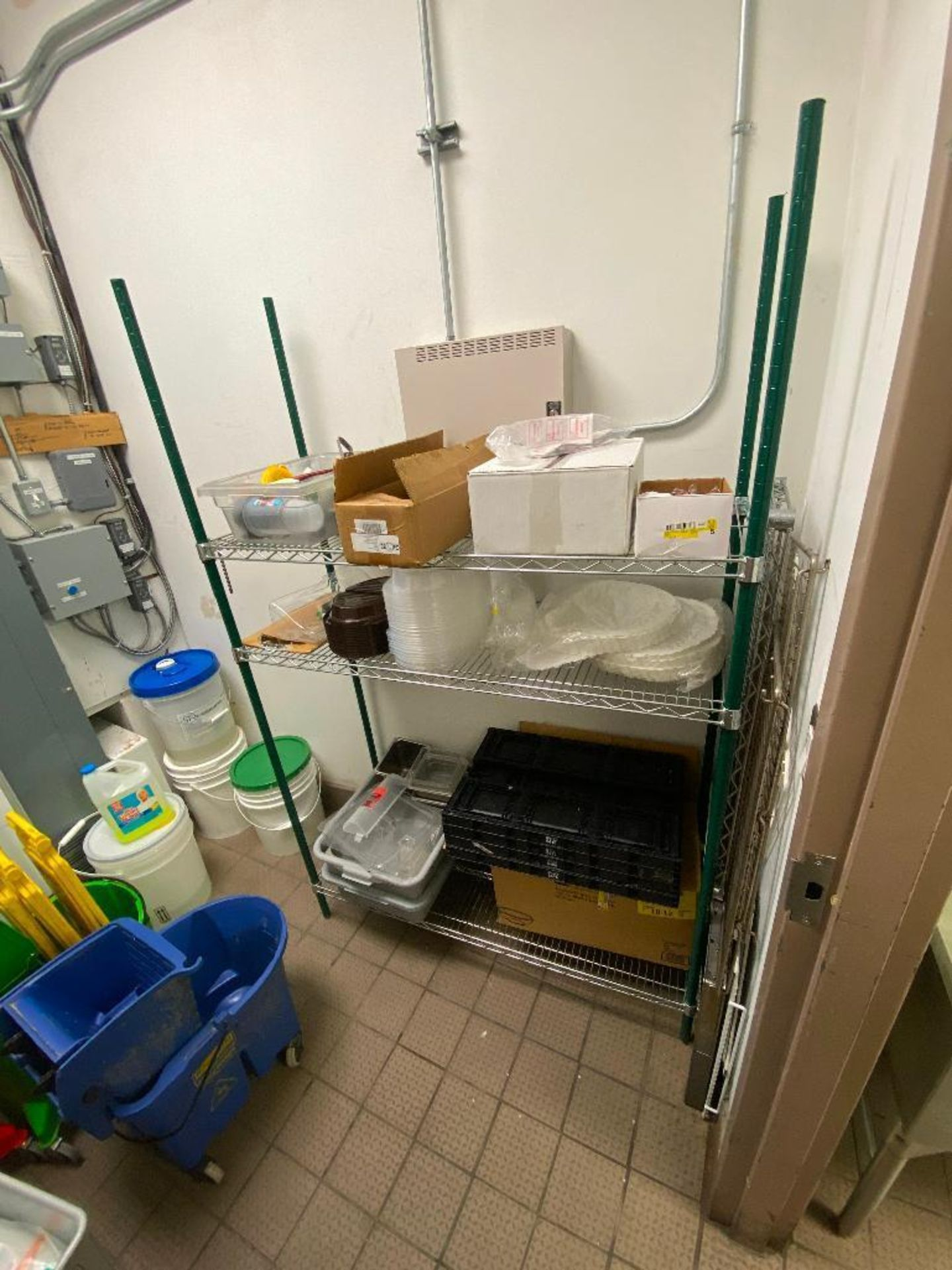CONTENTS OF STORAGE ROOM INCLUDING: 3 TIER WIRE STORAGE RACK, (3) MOP BUCKETS, (2) ANTI FATIGUE MATS - Image 2 of 8