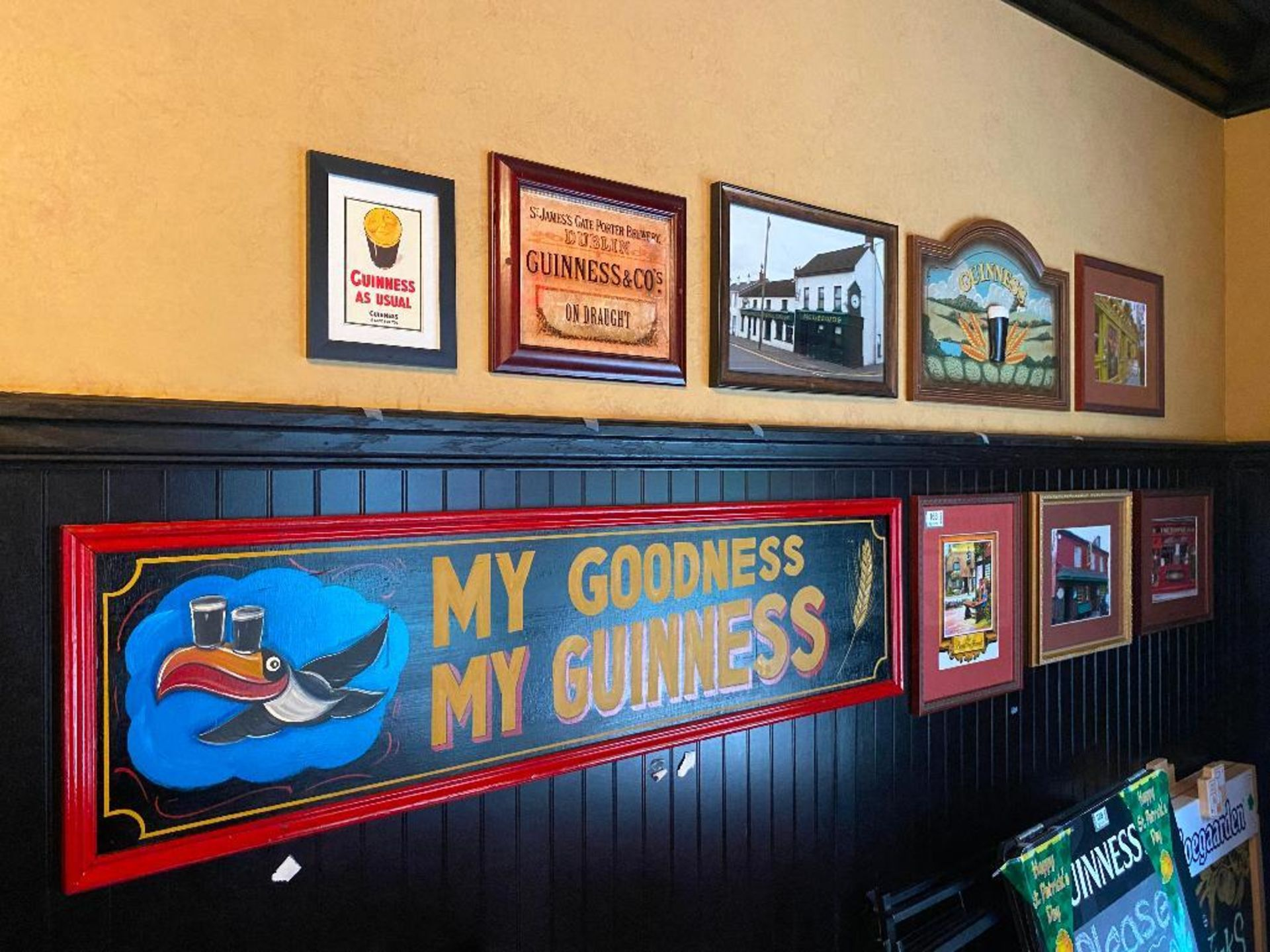 LOT OF (7) FRAMED MEMORABILIA PHOTOS & (2) WOODEN GUINNESS PLAQUES - NOTE REQUIRES REMOVAL FROM WALL
