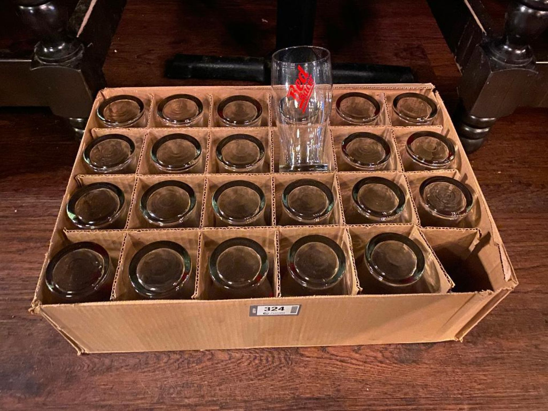 BOX OF RED RACER BEER GLASSES