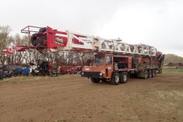 2006 Crane Carrier Class III Free Standing Double Mast Mobile Service Rig, VIN 1CYEHR688AT049767.