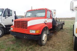 1992 International 4700 Single Axle Deck Truck, VIN 1HTSCPLM8NH438297.