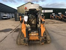 Case model TV380 tracked mini loader with water suppression system, piped for attachments, serial
