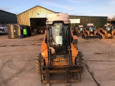 Case model SV250 wheeled mini loader with water suppression system, piped for attachments, serial