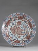 China dish, Yuan, decorated with a Phoenix, in Copper Red, on a background of Chrysanthemums, painte