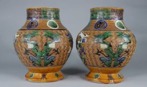 Pair of Fahua Tongzhi vases decorated with dragons in relief