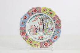 China famille rose plate with a beautiful decoration of a woman in the garden 18th