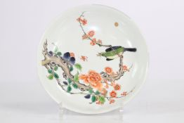 China Kangxi porcelain plate decorated with a trendy bird (restauraton)
