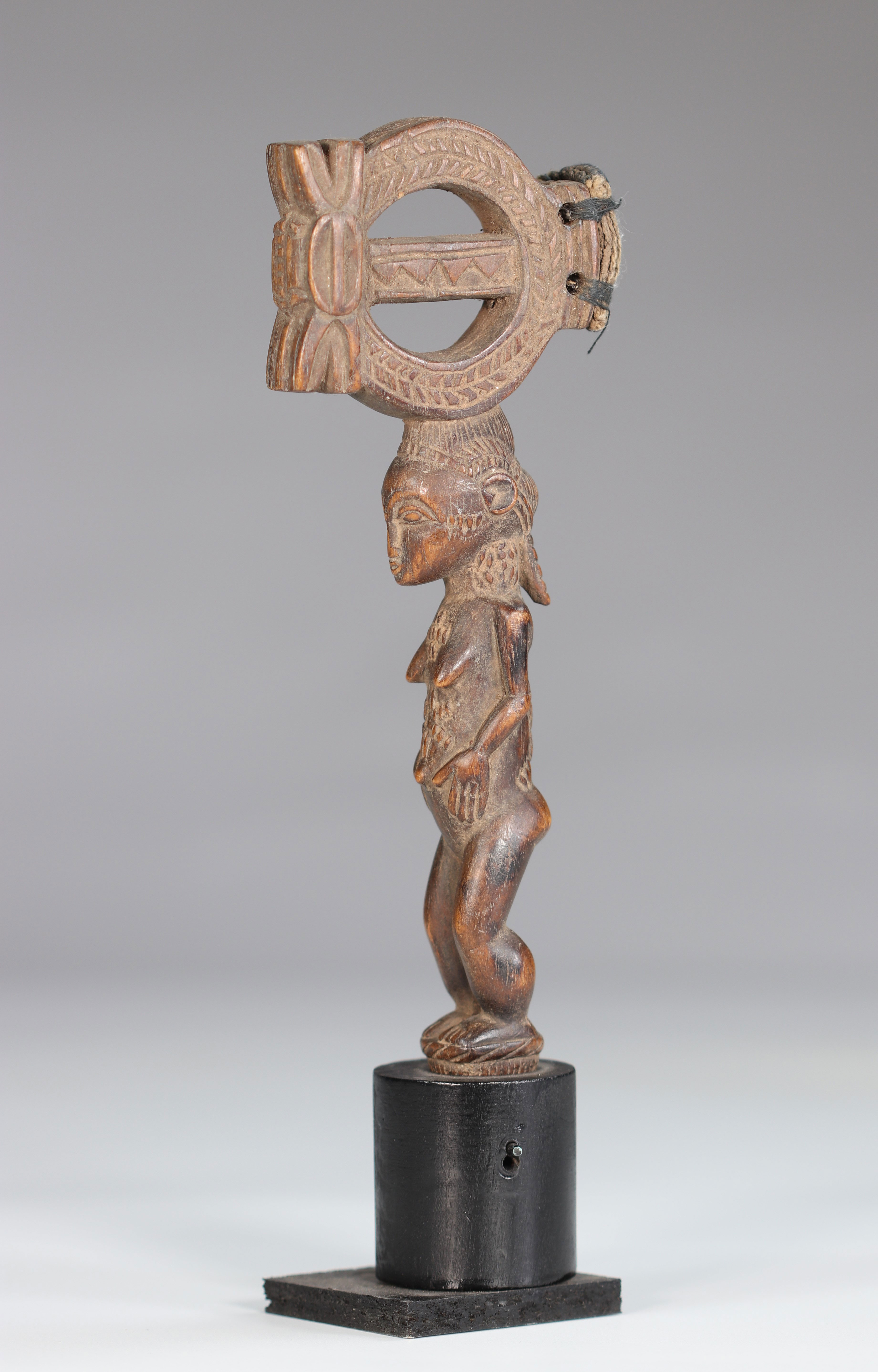 Baoule wooden hammer carved of a female character