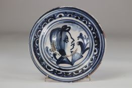 Delft? plate decorated with a woman's head probably 17th