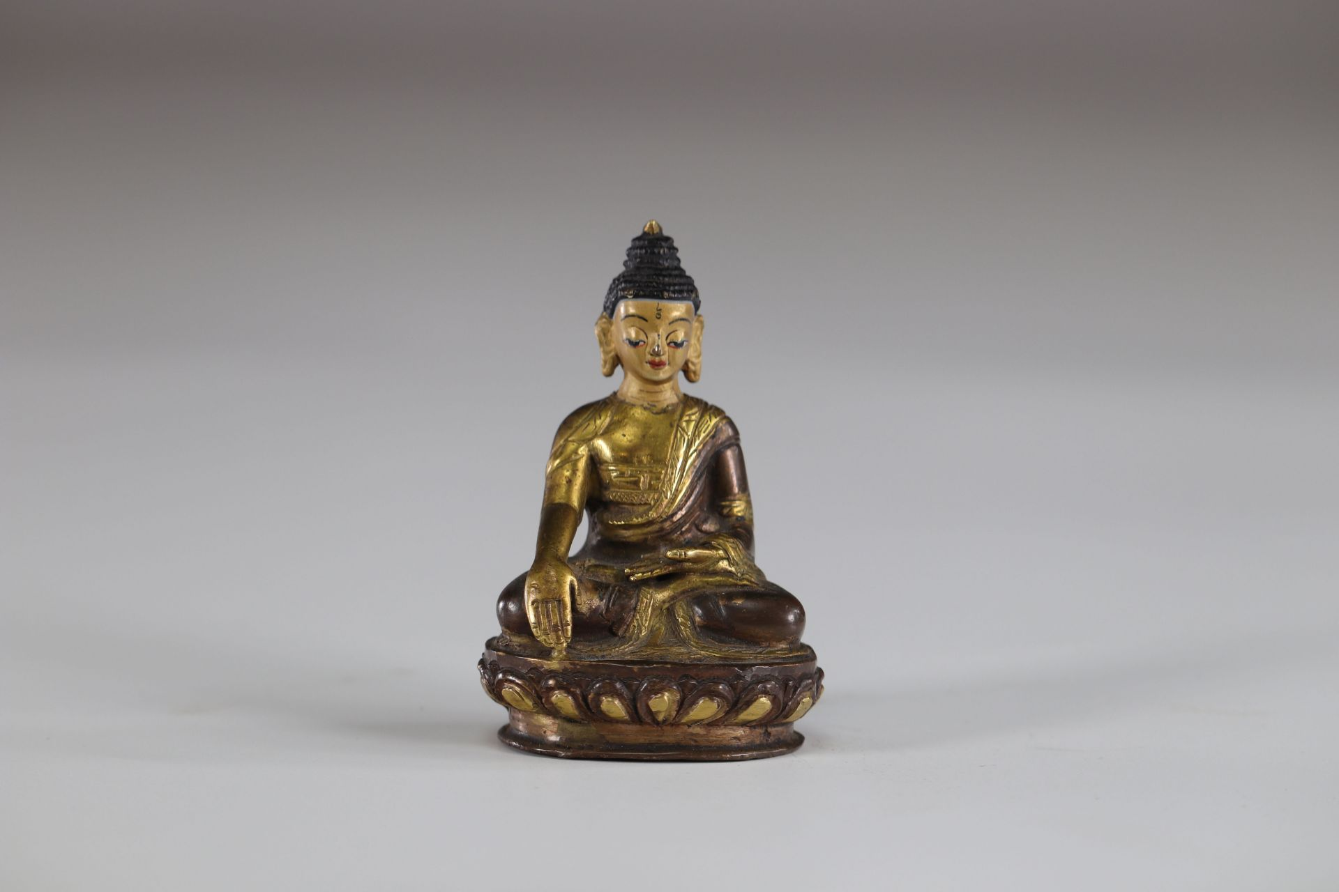 Asia buddha in gilded bronze