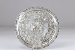 Silver dish in the center a lion probably India