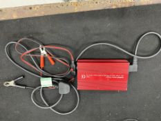 Numax P/N 121000 battery charger, DC. 12V/10A input, AC 100-240 volts. Rohs/CE marked. S/No.