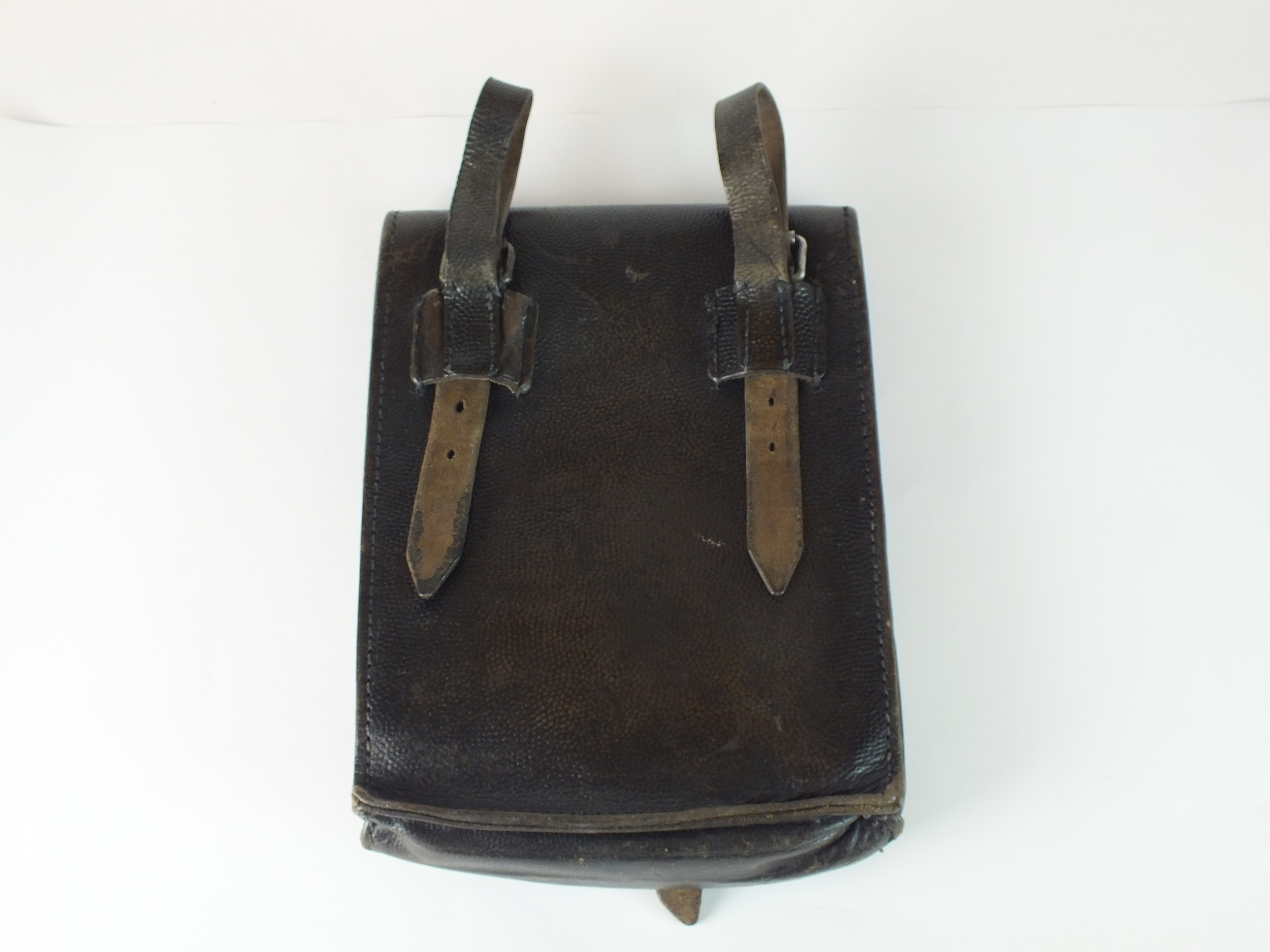 A German M35 black leather map/dispatch case, dated 1942, with twin map compartments and