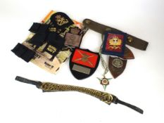 A collection of assorted militaria comprising an Airborne Forces Golden Jubilee glass paperweight,