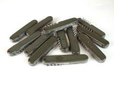 Twelve West German Swiss Army knives