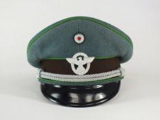 A German Third Reich Schutzpolizei (Protection Police) Officer's visor cap
