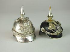 Two miniature pickelhaube desk ornaments