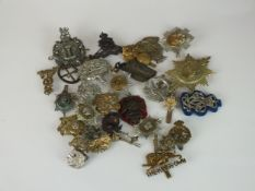 A collection of 30 assorted army badges including The King's Own Scottish Borderers, Engineers, etc
