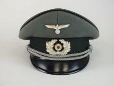A German Second World War Heer (Army) Pioneer Officer's visor cap