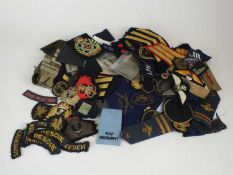 A mixed collection of predominantly post-war military cloth insignia and a Scottish sgian dubh