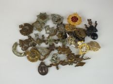 A collection of 30 assorted army and other badges ncluding Royal North Lancashire, East