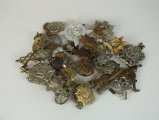 A collection of 30 assorted army badges