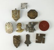 A collection of German tinnies and badges