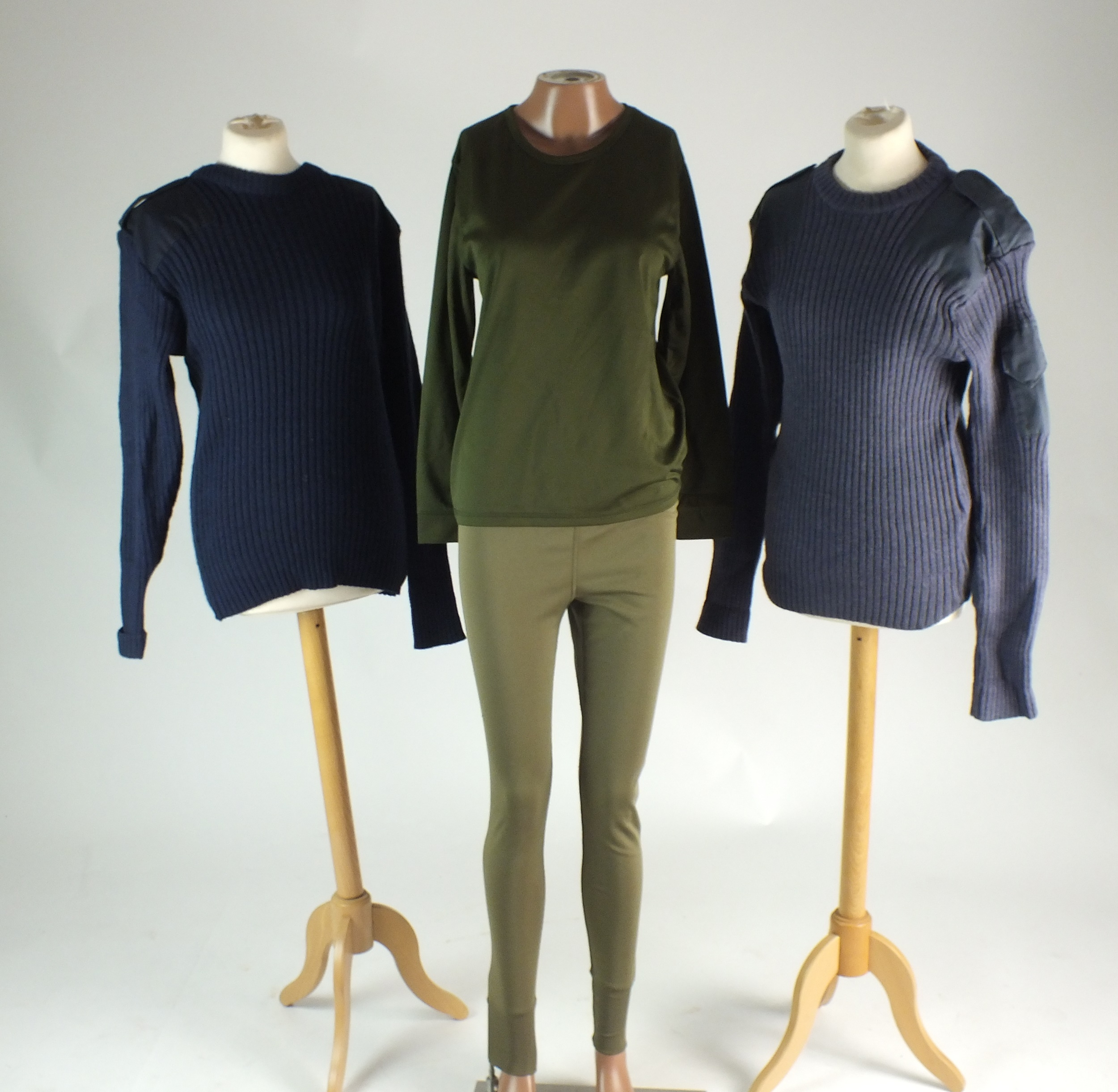 Mixed lot of surplus including a quantity of thermal olive green long-sleeved shirts and leggings