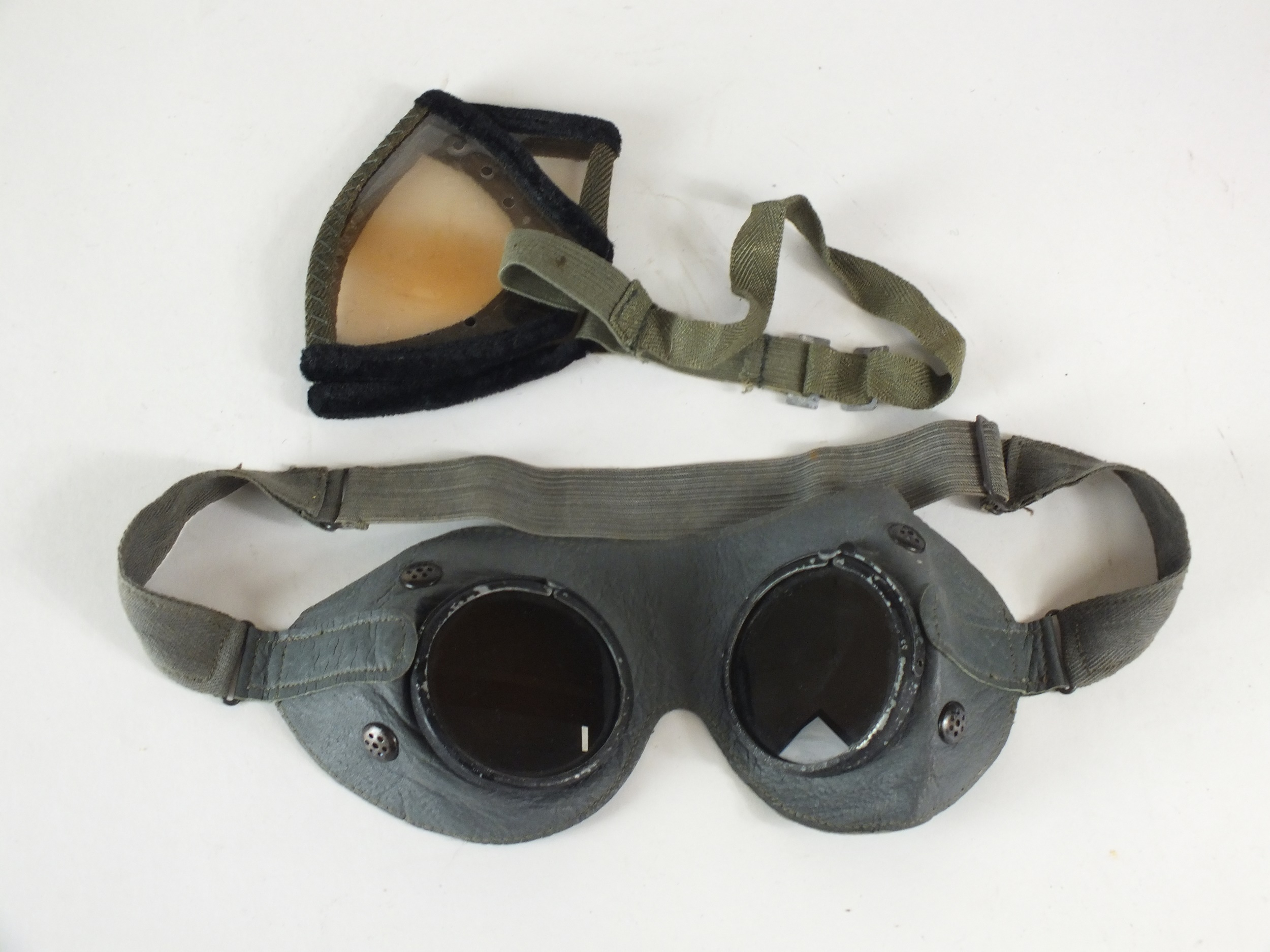 A pair of German WW2 tropical dust goggles together with a pair of German WW2 grey leather