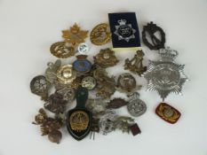 A collection of 30 assorted army, police, Scottish clan, boy scout, a relic WW2 German badge etc