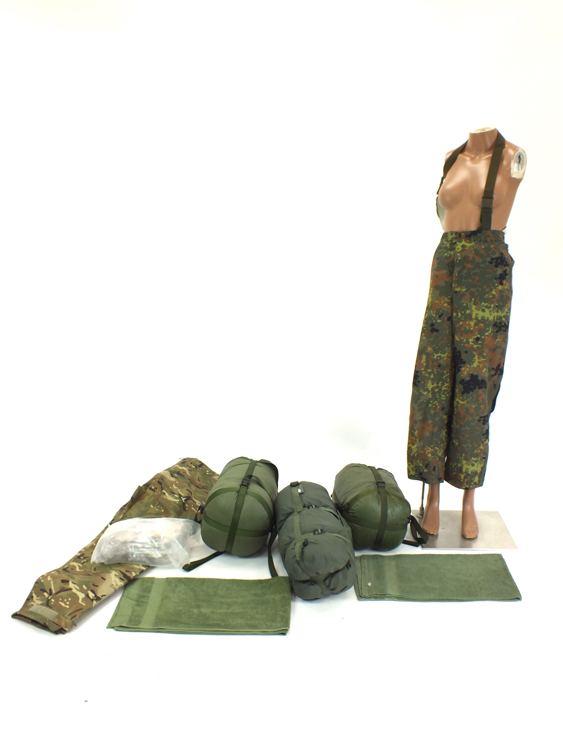A collection including three military sleeping bags, military hand towels, numerous pairs of