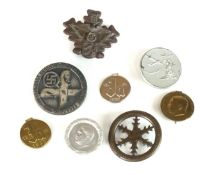 A collection of German Third Reich tinnies and badges