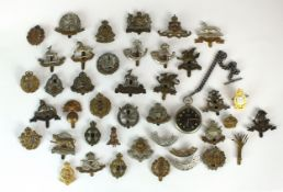 Collection of British cap badges and a Cortebert military watch
