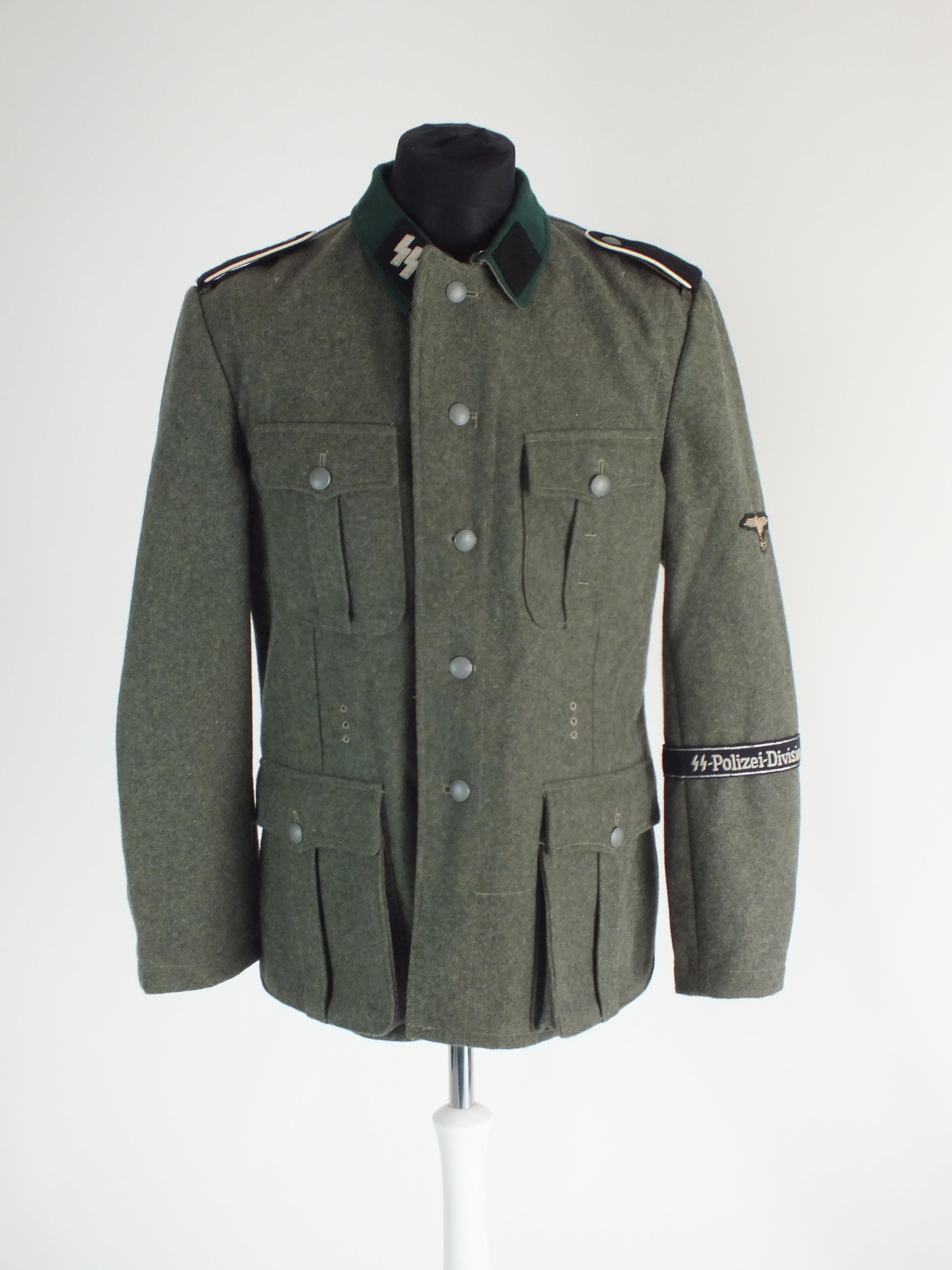A good re-enactor or film set prop uniform for a German SS Polizei Division Mann, the tunic with