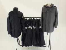 Thirteen Royal Navy wet weather waterproof navy jackets and two German dark blue windbreaker