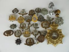 """A collection of 30 assorted army badges etc to include a """"Lincolnshire"""" shako plate"""