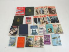 A group of military-related books and literature, including Medals Yearbook 2010, numerous issues of