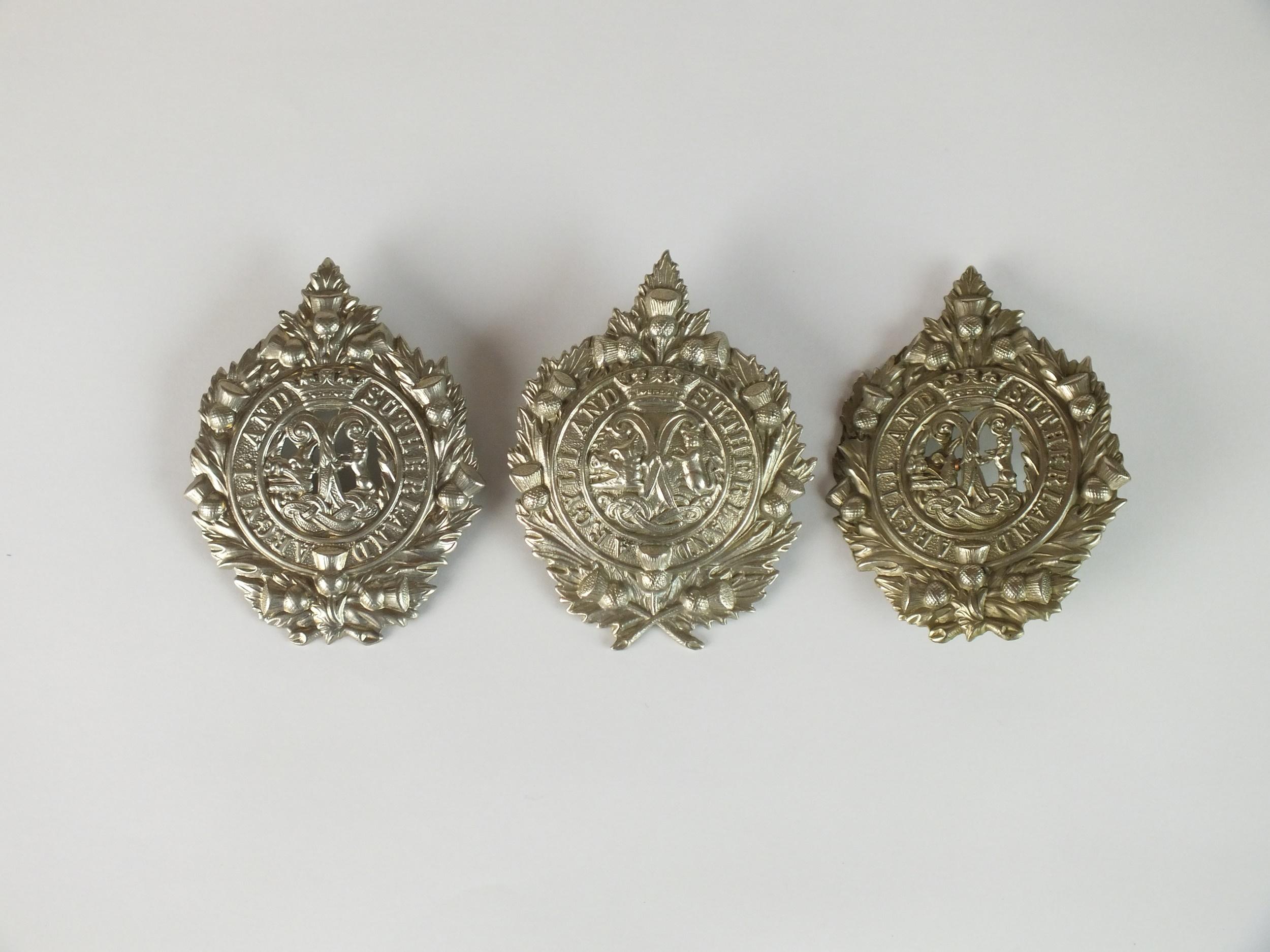 Three Argyll and Sutherland glengarry badges, die-stamped white metal (3)