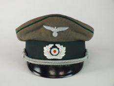 A German Army Administration Officer's visor cap, Austrian-made