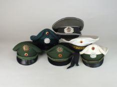A group of post-war German caps