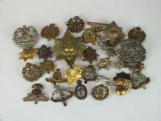 A collection of 30 assorted army badges etc