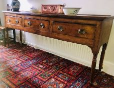 A George III elm dresser, circa 1780, fluted edge top in a rectangular form on a moulded cornice,