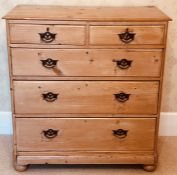 A late Victorian pine chest of drawers, slight oversailing moulded edge top, above two and three